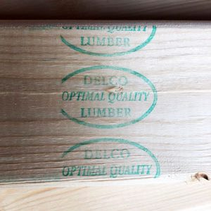 Delco Lumber Quality Stamp