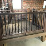 Trex Railing Transcend Crown Top Rail in Vintage Lantern with Aluminum Round Black Balusters