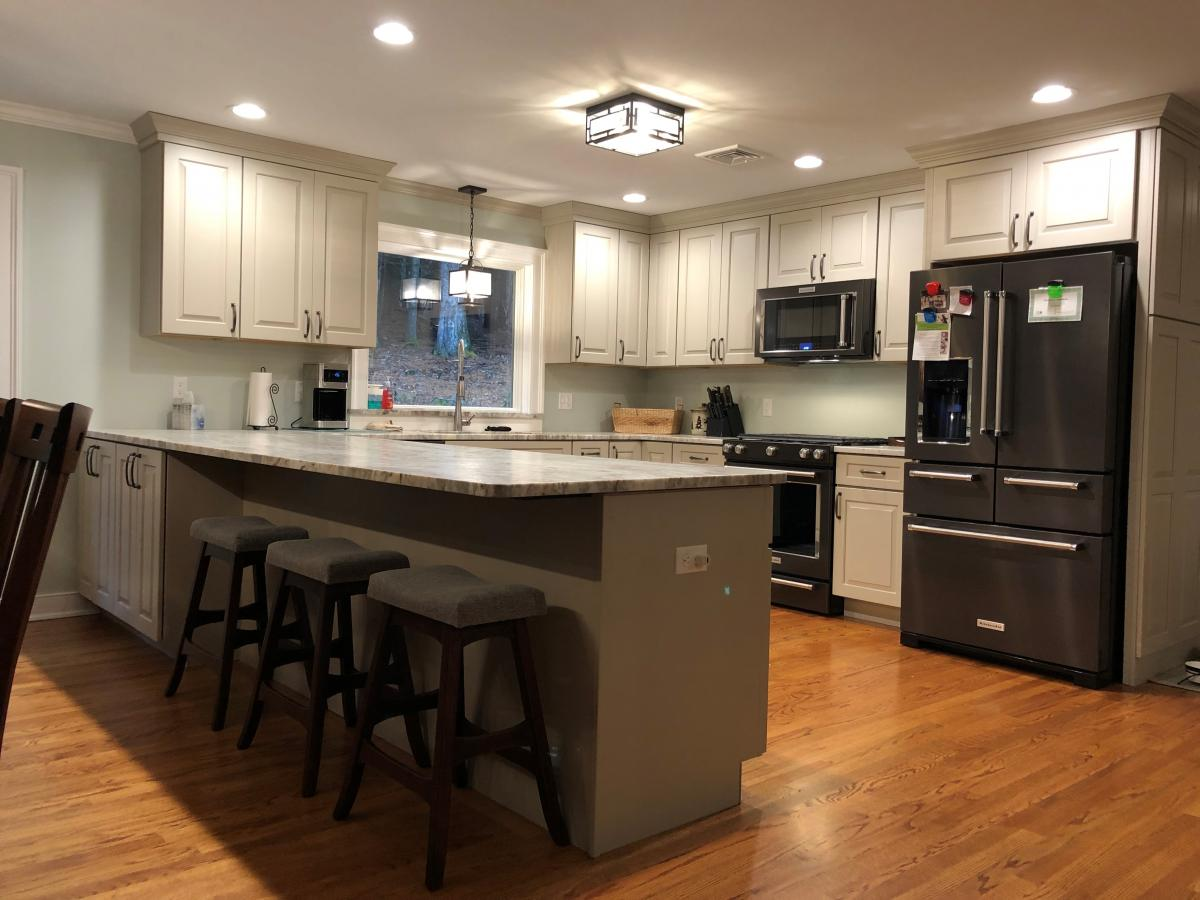 Paige O'Coin designs a wide open kitchen for Proulx Building and Remodeling